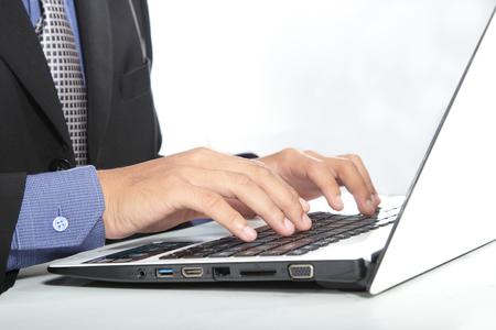 person computer: Business person working on computer against technology background