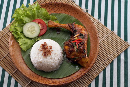 recipe background: roasted chicken with cooked rice in traditional food Stock Photo