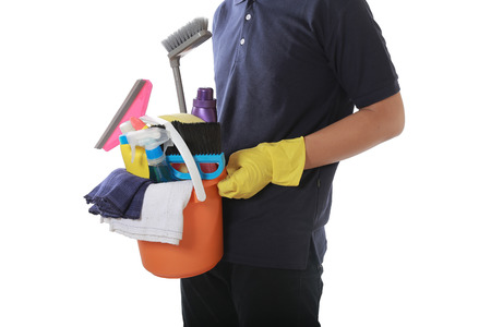attractive man standing with cleaning service