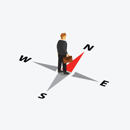 businessman standing in compass