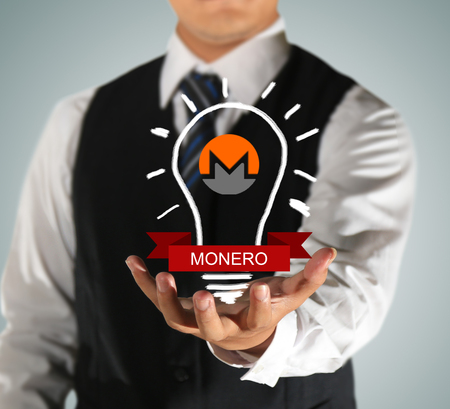 businessman holding financial success with monero finance Stock fotó