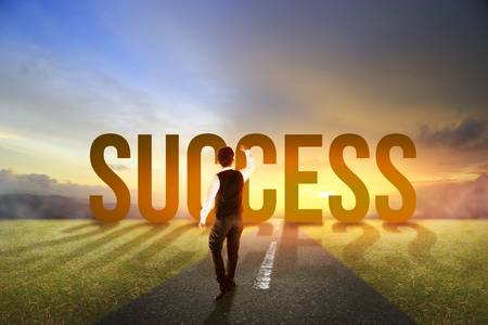 business man walking into success arising in the morning glory