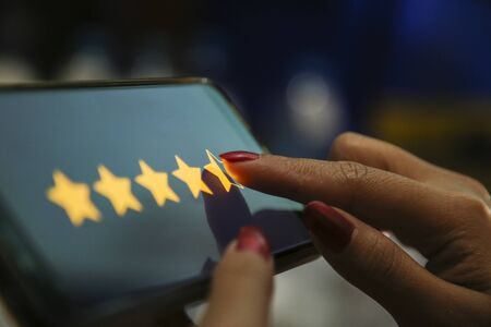 hands showing four point five stars on a smart phone