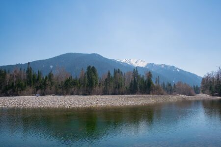Mountain river with a view of the beautiful mountains
