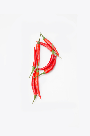 Bold letter P Latin alphabet of red hot chili pepper on a white background