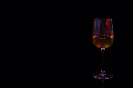 Beautiful full color glass of white wine on black background
