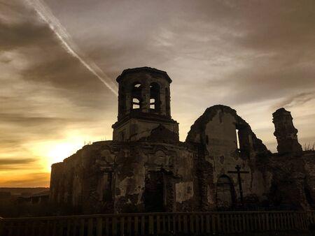Bleak ruins of an abandoned Church on the backdrop of an ominous sky.