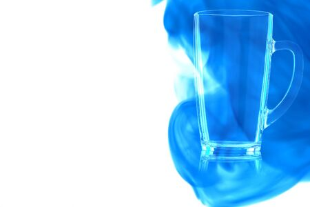 An empty beer mug on white background enveloped in puff of blue smoke. Place for your text. Banque d'images