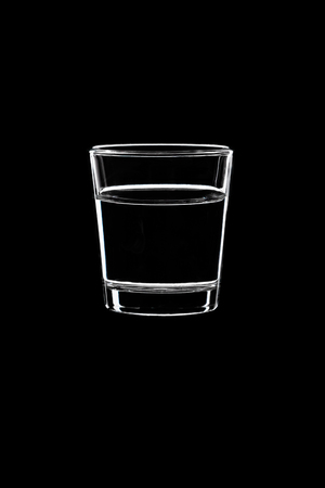 A small shot with vodka isolated on black background.