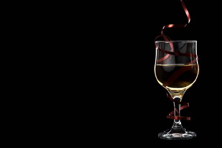 Filled white wine glass with red ribbon isolated on black background. Place for Your text. Banque d'images