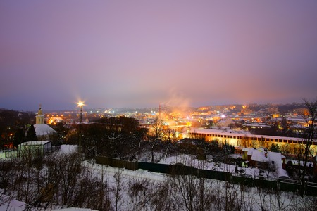 Beautiful views of evening Smolensk in the winter. Evening Smolensk in winter - snow covered snow blanket the earth, see the bright lights of the evening city. far - wall, visible Church and lots of old architecture mixed with modern buildings.