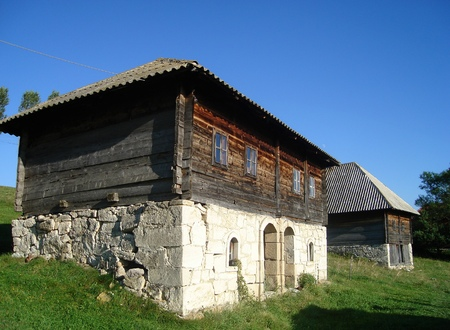 husbandry: Old Serbian houses built of stone and wood .
