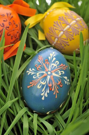 eastertime: Colorful painted easter eggs in the grass
