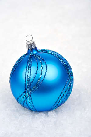 'christmas ball': blue Christmas ball in the snow Stock Photo
