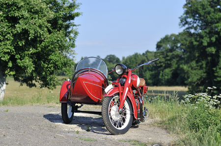 sidecar: old red sidecar on the road