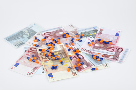 scrap trade: euro banknotes and colorful pills Stock Photo