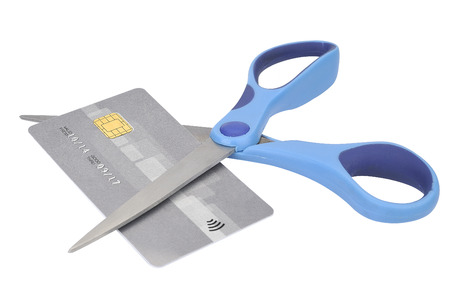 overdraft: Cutting up Credit Card With blue Scissors Stock Photo