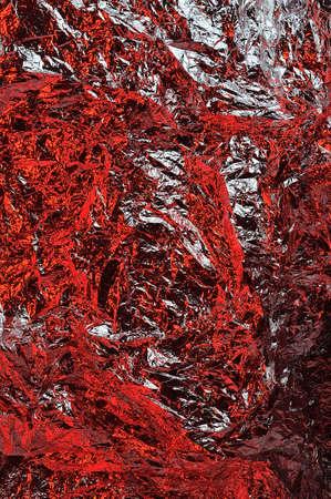 metalic texture: Red color textured aluminum foil Stock Photo