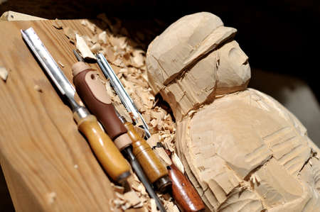 semifinished: chisels with a wooden statue Stock Photo