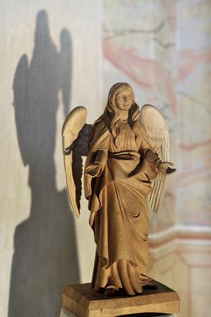 enlightened: wooden enlightened angel in church