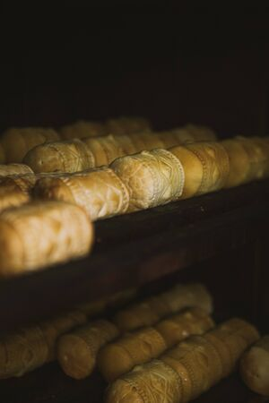 Smokehouse with traditional sheeps milk cheese - oscypek. Oscypek is a smoked cheese made of salted sheep milk exclusively in the Tatra Mountains region of Poland.