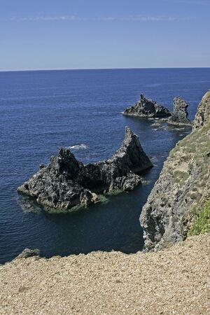 belle: Belle Ile, Les aiguilles de Port Coton, Brittany, Northern France Stock Photo