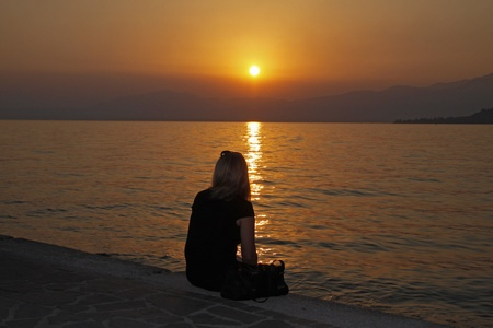dark blond: Woman looking over at the sunset