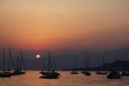At the promenade of Bardolino, Lake Garda in Italy in the evening photo