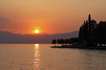 Sunset in Bardolino at Lake Garda, Italy, Europe Фото со стока