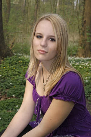 17 years: Young blonde girl (17 years) in a deciduous wood in spring, Germany, Europe