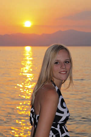 Blonde girl (17 years) at the promenade of Bardolino at Lake Garda, Italy, Europe photo