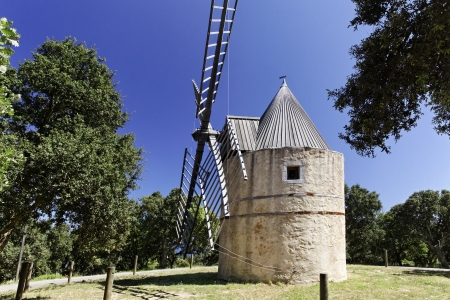Grimaud, 17th century Saint Rochs windmill  Moulin de la Gardiolle, Moulin St Roch , Cote d Azur, Southern France, Europe photo