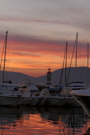 Saint-Tropez, sailing masts with lighthouse in the sunset light, Cote dAzur, French, Riviera, Provence, Southern France, Europe photo