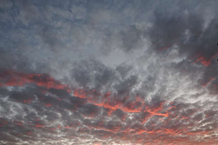 clouded: Evening sky with dark and red clouds in Lower Saxony, Germany, Europe