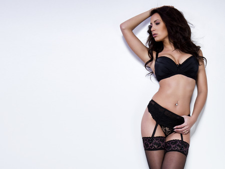 sexy lingerie: Beautiful brunette young woman in sexy lingerie