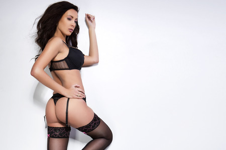 fashion doll: Beautiful brunette young woman in sexy lingerie
