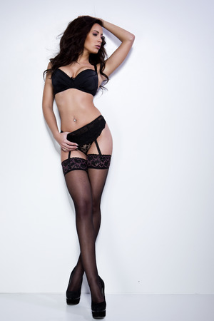 heel: Beautiful brunette young woman in sexy lingerie