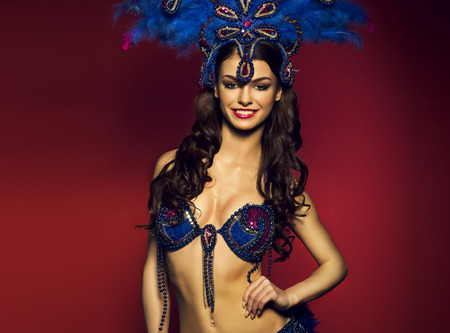 costumes: Sensual brunette wearing Samba dancer Costume