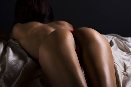 sexy nude women: Perfect sexy and fit buttocks in red lingerie close-up