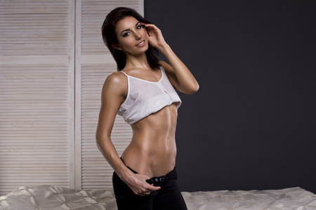 thin: attractive fitness woman, trained female body, lifestyle portrait, caucasian model Stock Photo
