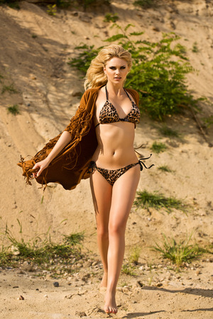 nude female buttocks: Portrait of beautiful sexy young lady on the sand ground on sunshine outdoors background