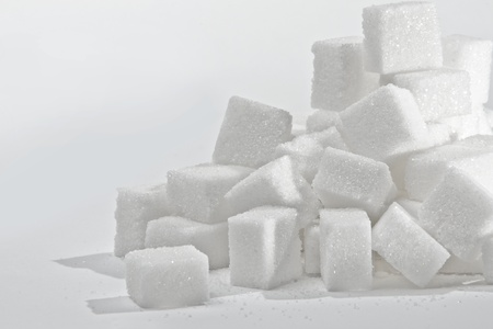 sweetener: Close up on the stack of white sugar cubes.