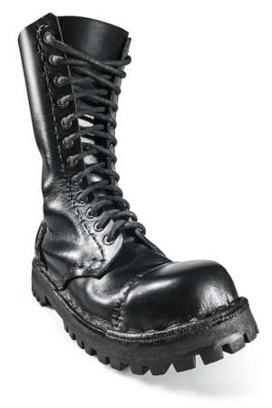 anarchy: Close-up on the black, shiny, hand made army boot  Stock Photo