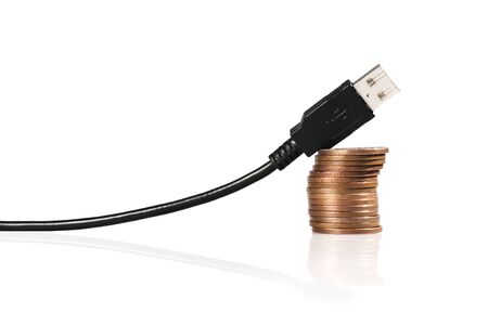 USB cable in the shape of the graph, supported by stack of coins Stock Photo - 13790556