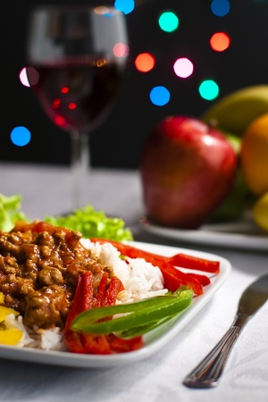 Dinner on tabletop with wine, fruits and bokeh lights in background Stock Photo - 19080450