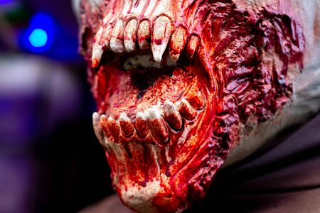 Open mouth showing vampire teeth on a decaying zombie