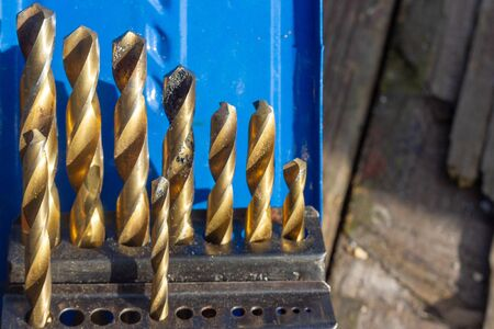 Shiny used drill bit set with measurements