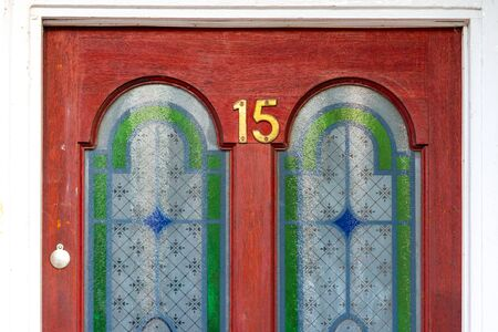 Beautiful door with stained glass and the house number 15 Stock Photo