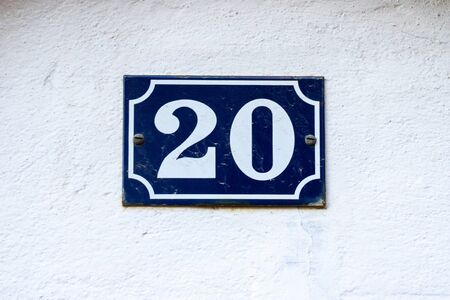 House number 20 on an enamel sign