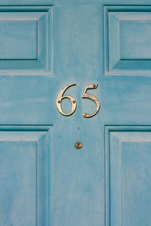 House number 65 Stock Photo